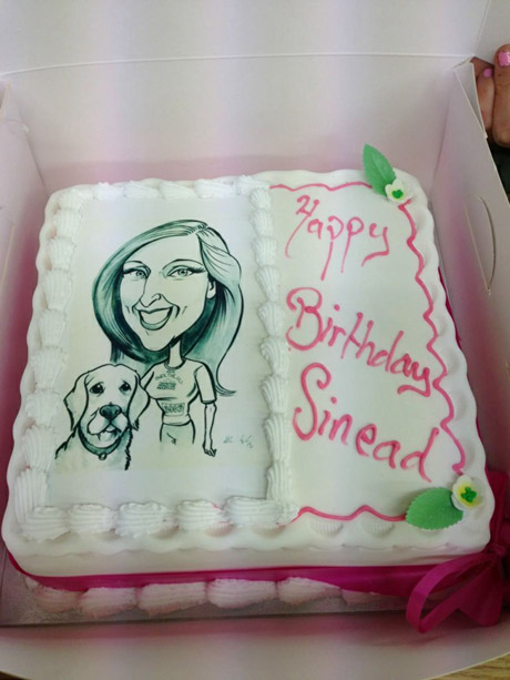 A birthday cake printed with a caricature on the icing, from Griffins Bakery Galway.