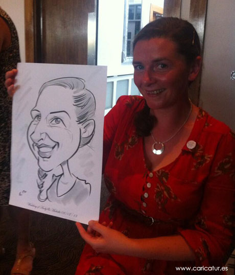 Woman in red dress at wedding with caricature by Allan Cavanagh