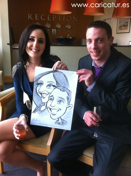 Couple laughing with caricature by Allan Cavanagh