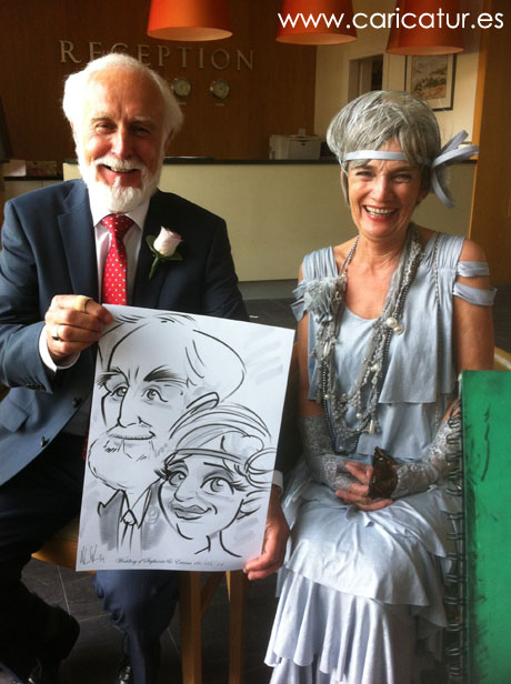 Glamorous couple with caricature by Allan Cavanagh in Kerry
