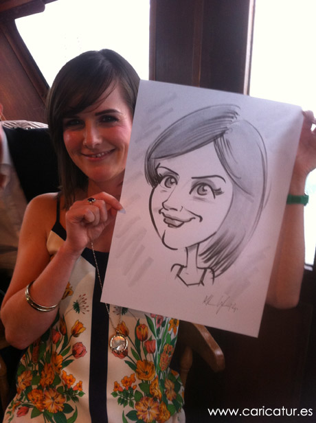 Woman laughing with her live caricature by Allan Cavanagh