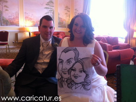Bride and Groom laughing with wedding caricature by Allan Cavanagh