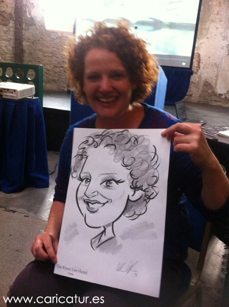 Photographer Joleen Cronin with her caricature by artist Allan Cavanagh