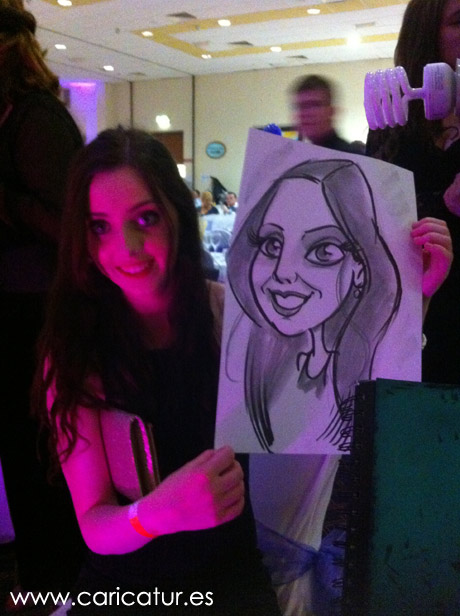 Young woman posing with caricature by Irish Caricature Artist Allan Cavanagh