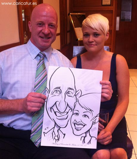 Couple with caricature by one of Ireland's leading wedding entertainers Allan Cavanagh