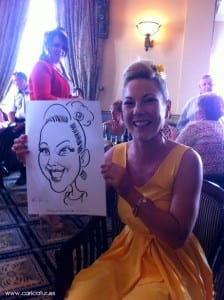 Wedding guest laughing having been drawn by Allan Cavanagh Caricatures Ireland
