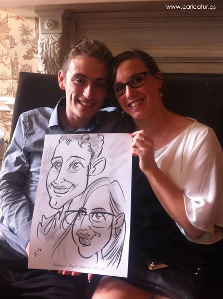 Laughing couple drawn by Irish caricature artist Allan Cavanagh