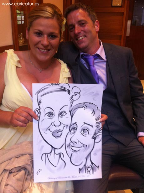 A couple having their caricature drawn by Irish cartoonist Allan Cavanagh of Caricatures Ireland