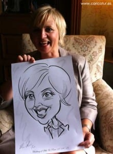 Woman laughing with caricature by Allan Cavanagh, Caricatures Ireland