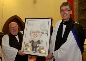 Archdeacon Robin Bantry White receiving a presentation from the Very Reverend Nigel Dunne, Dean of St Fin Barre's