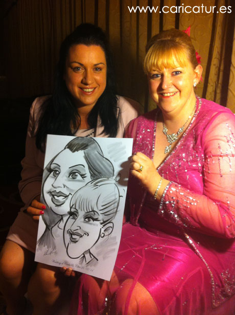 Laughing women with caricature by Allan Cavanagh Irish artist