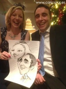 Wedding guests in Sligo laughing with their caricature by Irish Cartoonist Allan Cavanagh