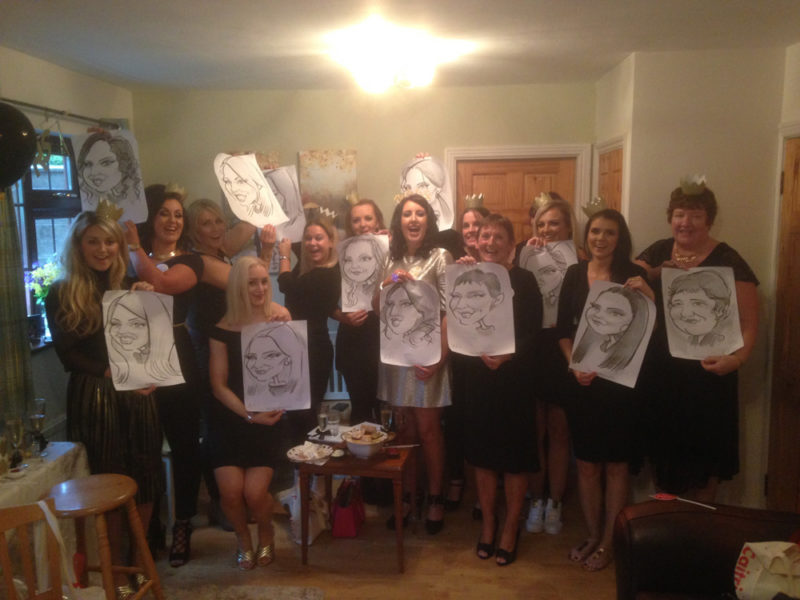 Group photo of a hen party with caricatures drawn by Allan Cavanagh