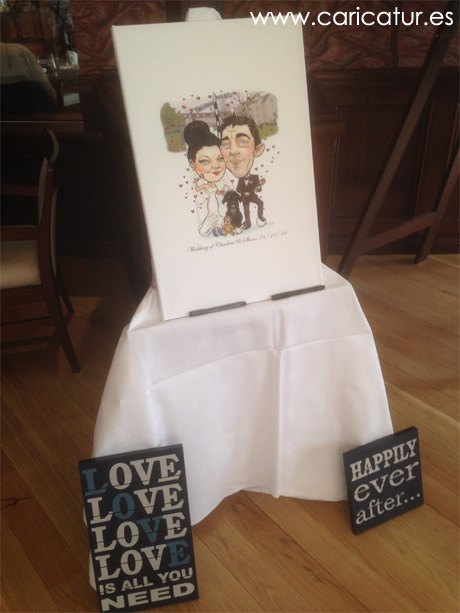 Canvas wedding signing board with caricature of couple in hotel on display