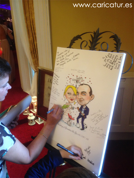 Guests signing canvas caricature wedding signing board by Allan Cavanagh