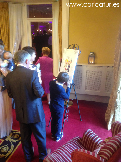Guests signing caricature guestbook by Allan Cavanagh