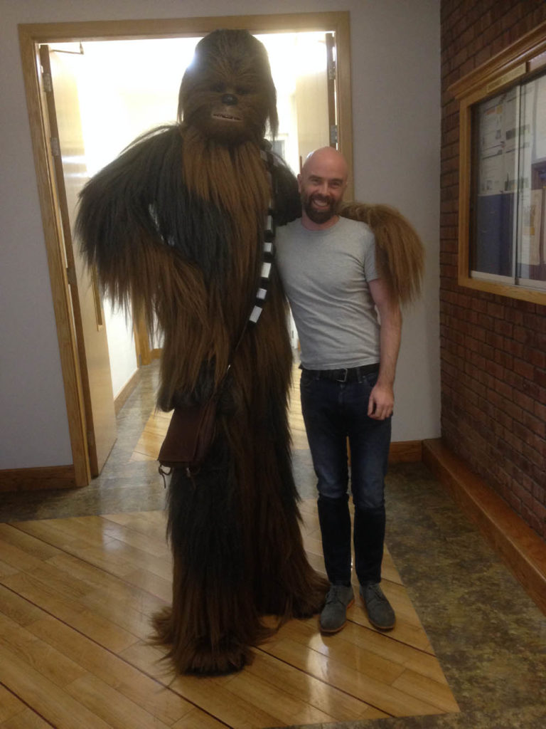 Caricature artist Allan Cavanagh with Emerald Garrison's Chewbacca at the Boston Scientific Children's Christmas Party