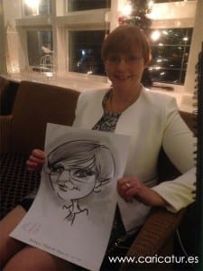 Woman with funny caricature drawing at a wedding, artist Allan Cavanagh