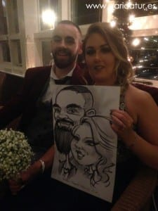 Young couple with custom caricature at wedding in Westwood Hotel Galway
