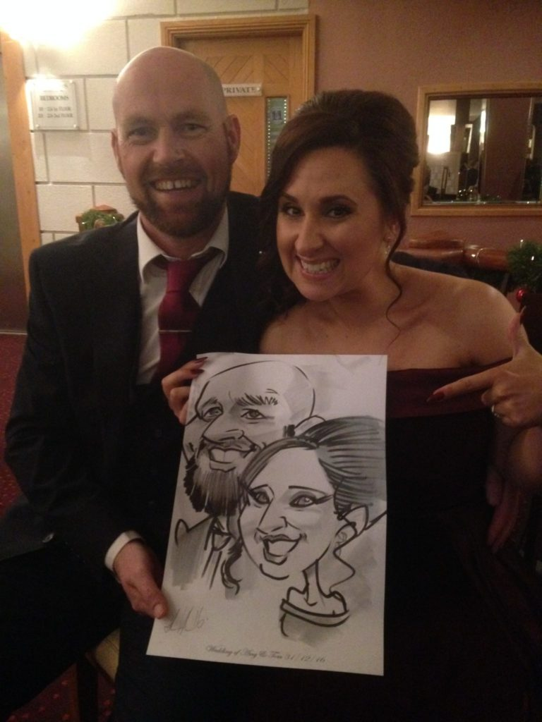 Laughing couple with caricature by Irish artist Allan Cavanagh, Woodlands Hotel, Waterford