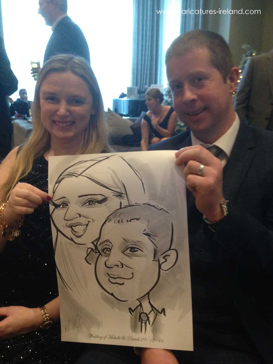 Couple with Caricature drawn by Allan Cavanagh in Lough Rea Hotel Galway