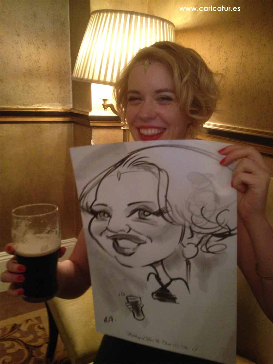 Wedding reception entertainment caricature of woman laughing holding caricature by Allan Cavanagh