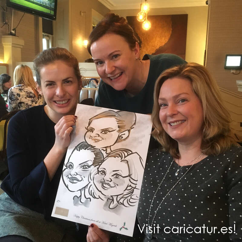 Caricature Artist 3 women with caricature by Allan Cavanagh