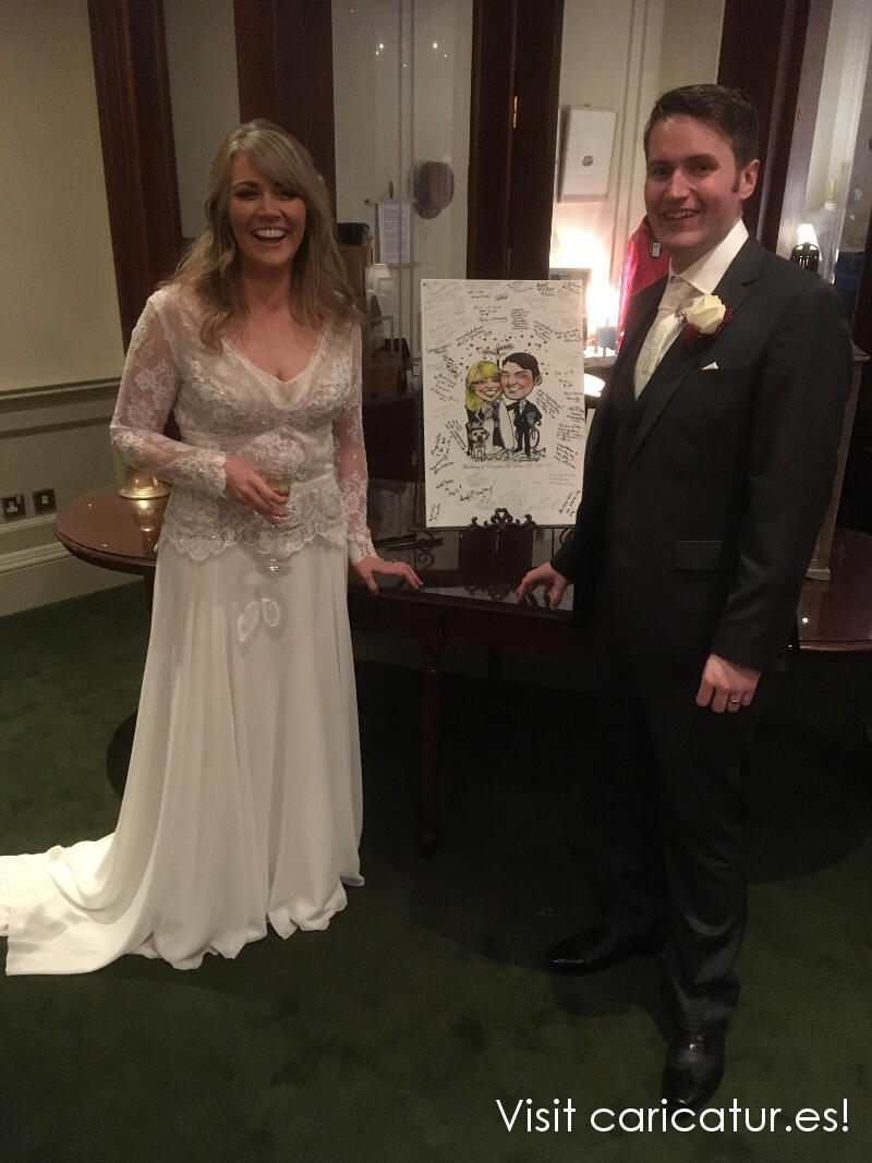 Newlyweds posing with canvas wedding signing board by Allan Cavanagh