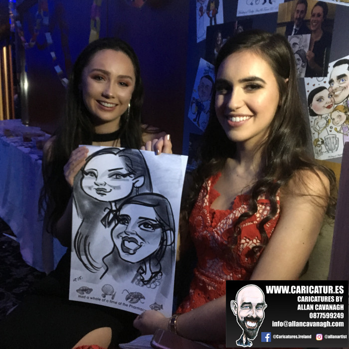 UCC Pharma Ball two women smiling with caricature