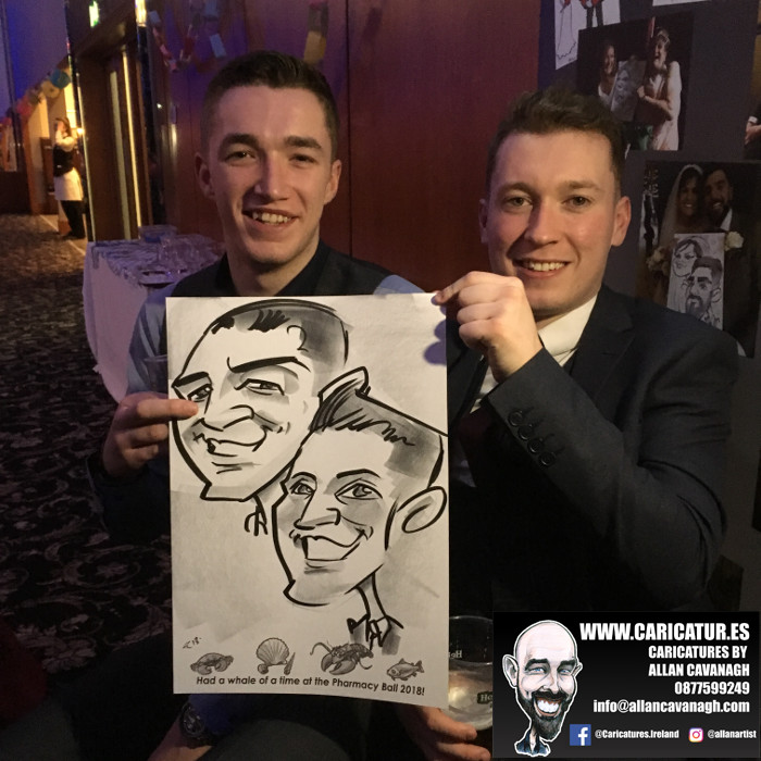 Two men smiling with caricature drawing