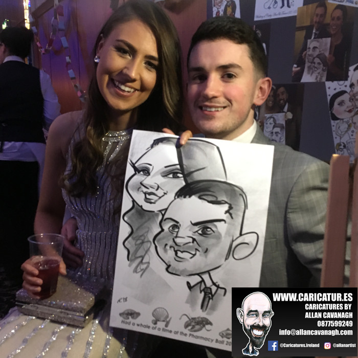 Man and woman smiling with caricature drawing