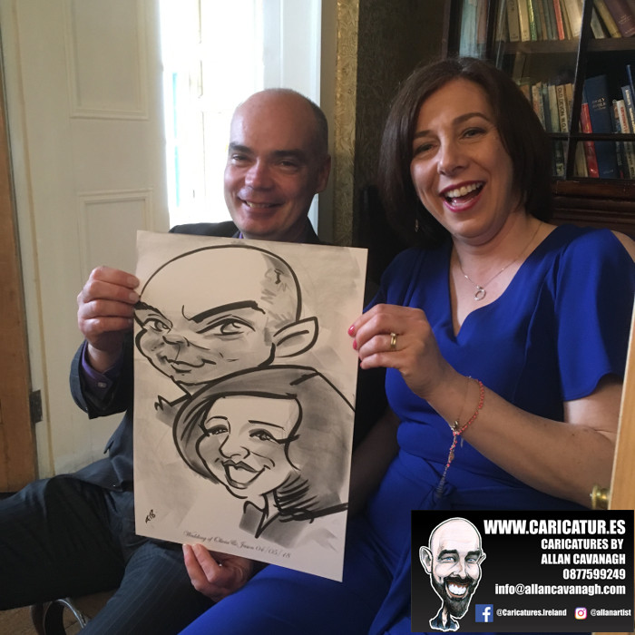 couple laughing with caricature
