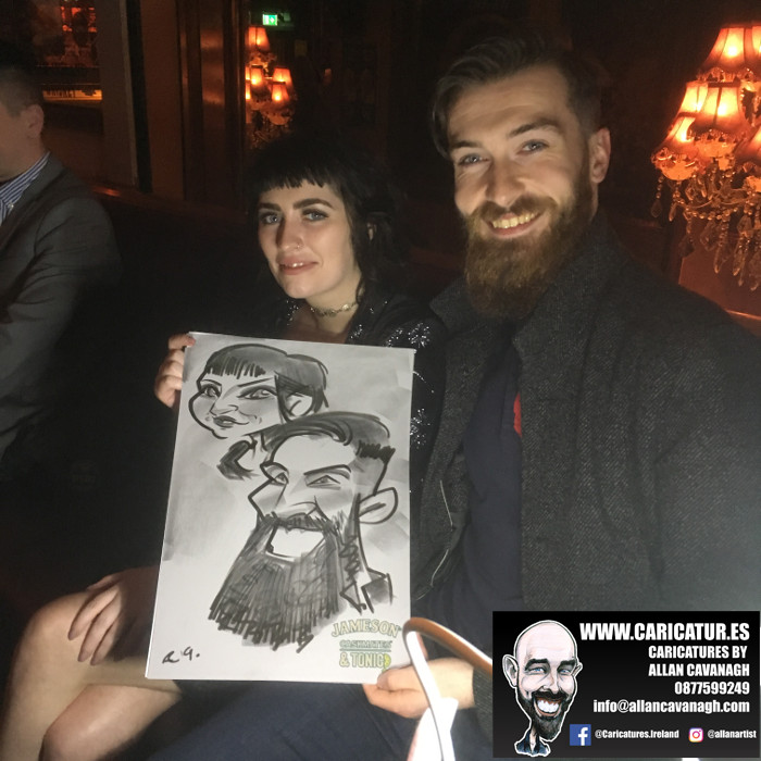 Couple holding caricature by Allan Cavanagh Galway Caricature Artist