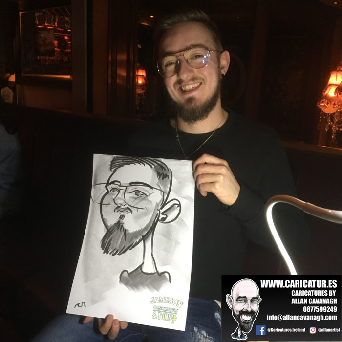 Man with beard holding caricature