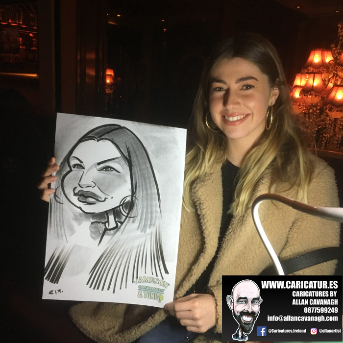 Smiling woman holding caricature