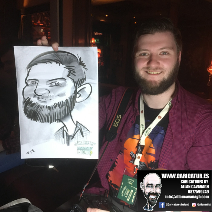 Bearded man holding caricature